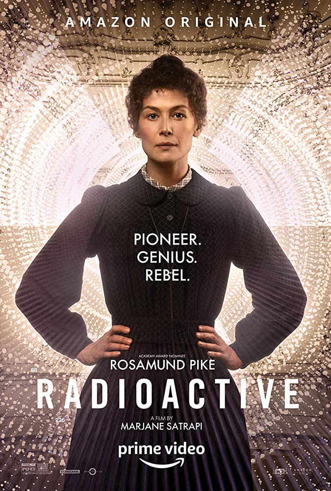 The FIlm poster showing Marie Curie (Rosamund Pike) with her hands in her waist.