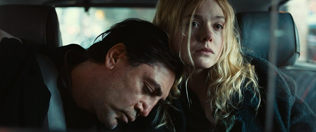 Leo (Javier Bardem) cuddles up to his daughter Molly (Elle Fanning) in the taxi.