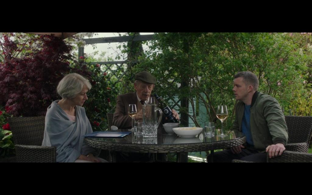 Betty (Helen Mirren), Roy (Ian McKellen) and Stephen (Russell Tovey) eating together.