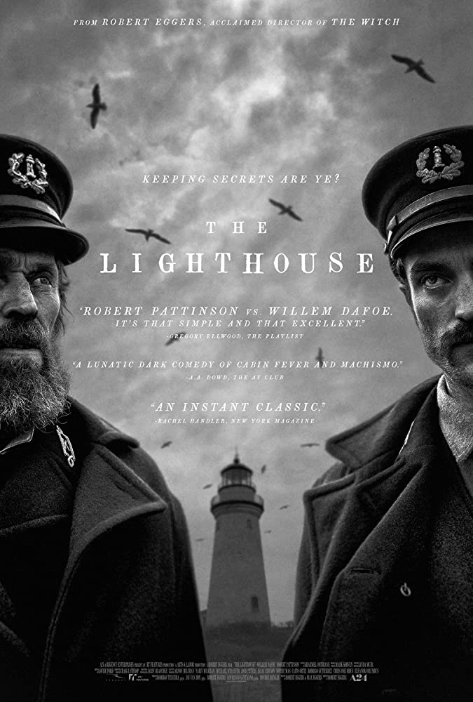 The film poster in black and white showing half of Thomas Wake (Willem Dafoe) and half of Ephraim Winslow (Robert Pattinson). Between them we can see a lighthouse circled by seagulls.