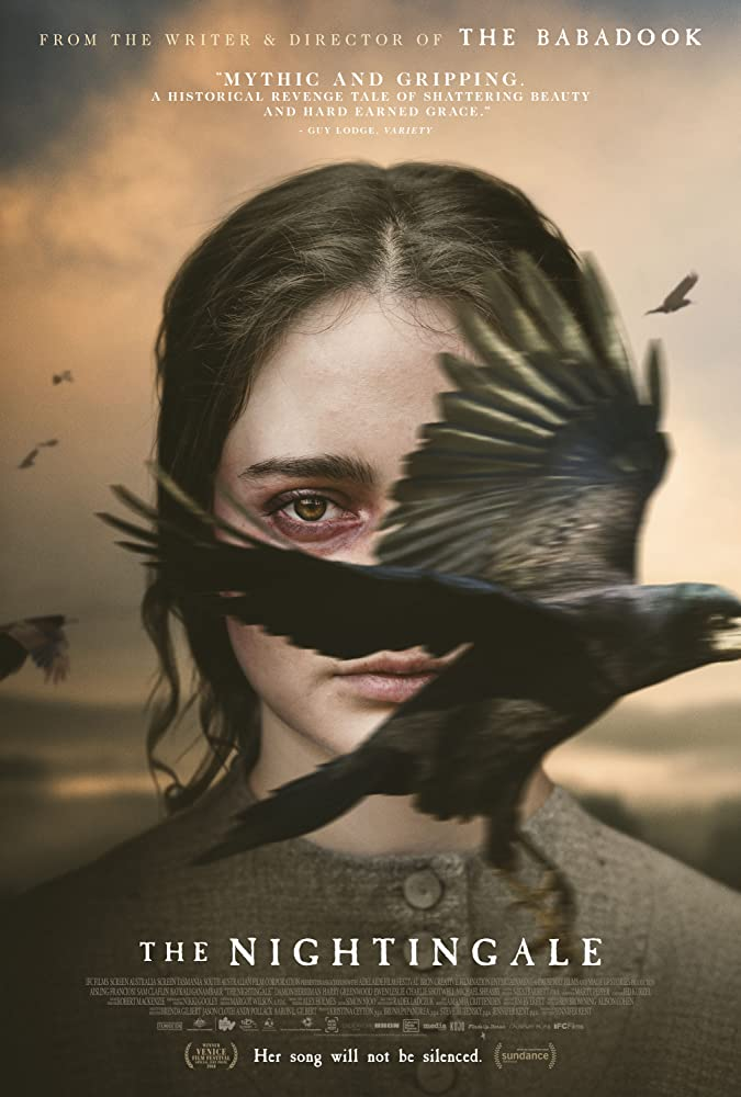 The film poster showing Clare (Aisling Franciosi) with a black bird flying across her face, covering half of it.