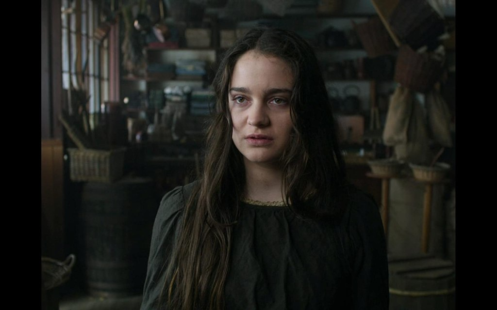 Clare (Aisling Franciosi) exhausted in a store.