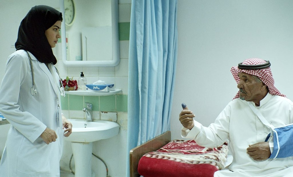 Maryam (Mila Al Zahrani) treating a patient.