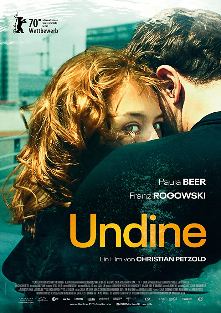 The film poster showing Undine (Paula Beer) in Christoph's (Franz Rogowski) arms, looking back over his shoulder.