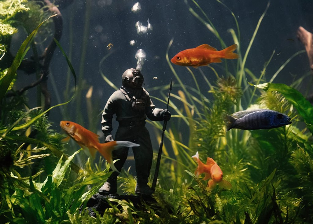 A figure of a diver in an aquarium.