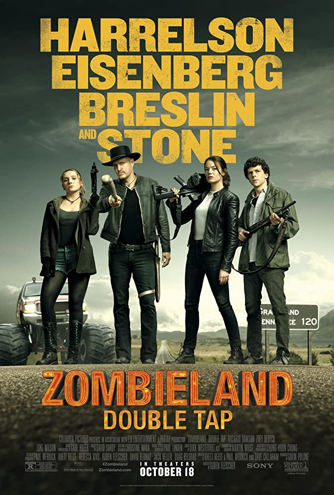 The film poster showing Little Rock (Abigail Breslin), Tallahassee (Woody Harrelson), Wichita (Emma Stone) and Columbus (Jesse Eisenberg) ready to fight.