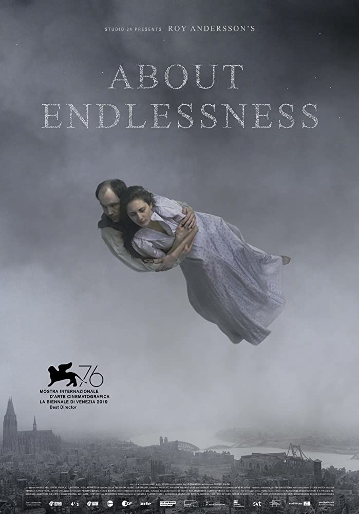 The film poster showing a man and a woman hugging tight as they fly over the city.