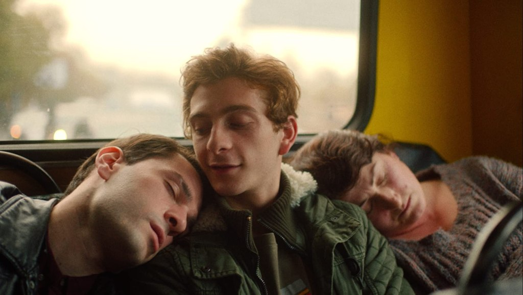 Irakli (Bachi Valishvili) sleeping on Merab's (Levan Gelbakhiani) shoulder on the bus.