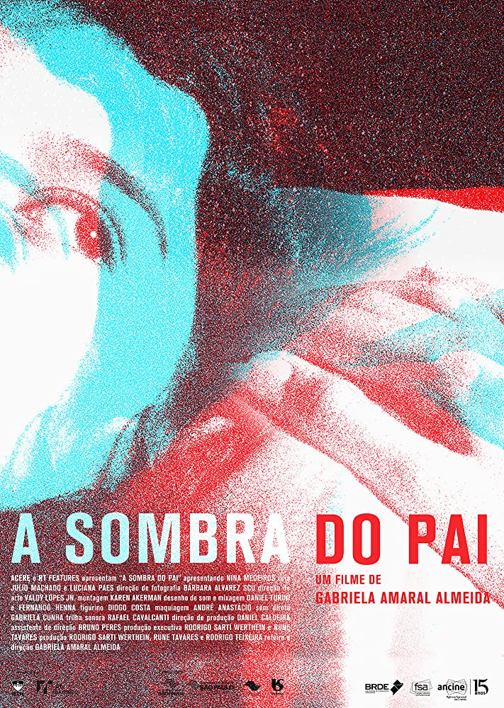 The film poster showing half of a face and clasped hands partly superimposed. The entire image is made up only of red and blue dots.