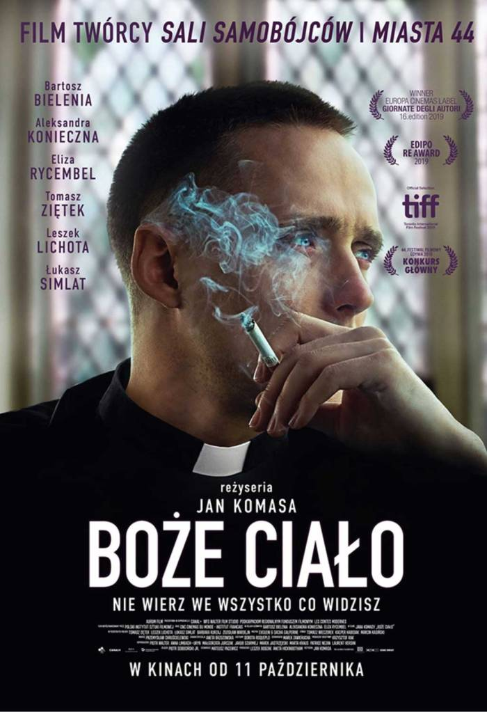 The film poster showing Daniel (Bartosz Bielenia) in a priest's robe, cigarette in hand.