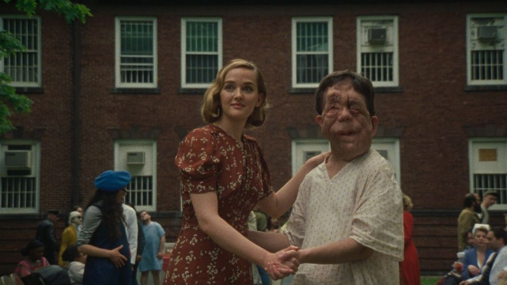 Mabel (Jess Weixler) and Rosenthal (Adam Pearson) in dancing position.