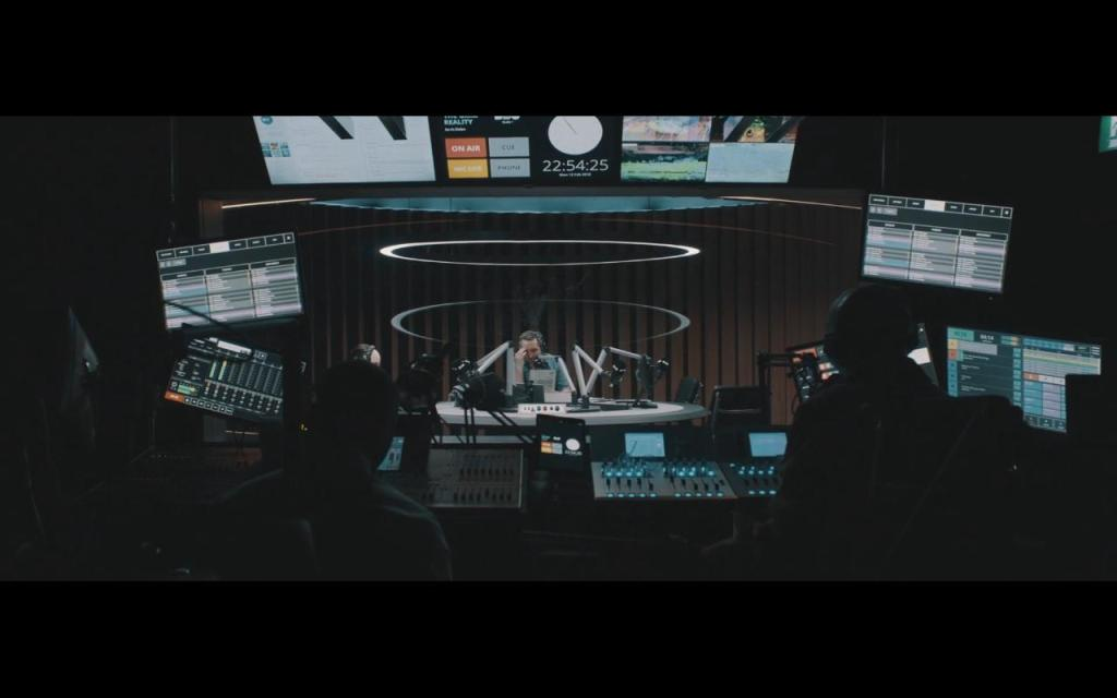 Jarvis (Eddie Marsan) sitting in the radio studio.
