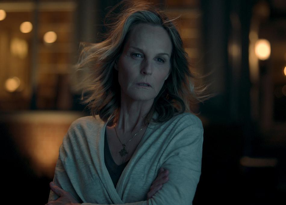 Jackie (Helen Hunt) standing outside at night.