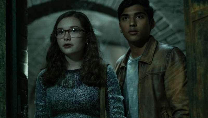 Stella (Zoe Margaret Colletti) and Ramon (Michael Garza) inside the house.