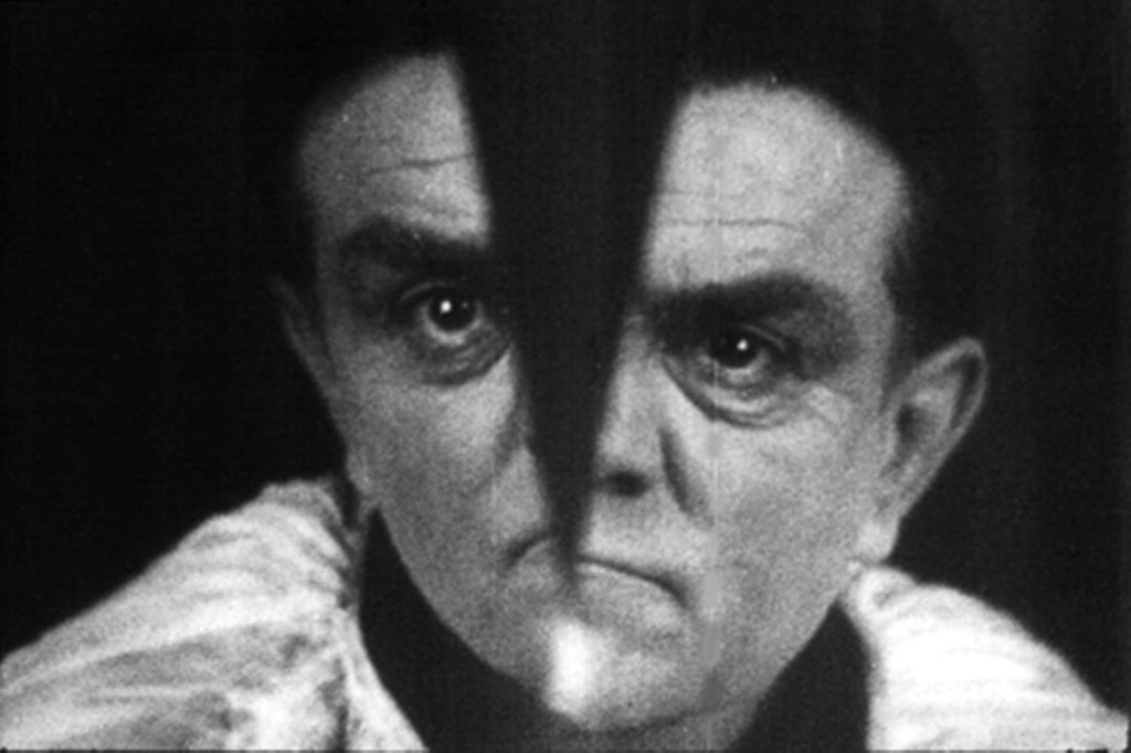 The General's (Lucien Battaille) face splitting in two.