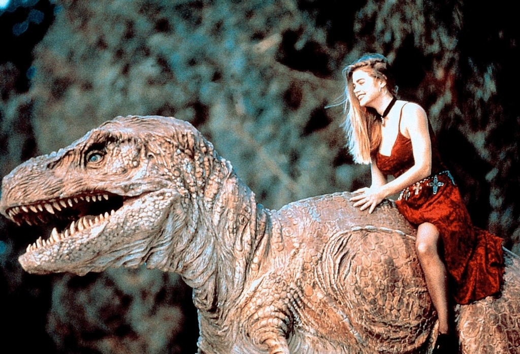 Tammy (Denise Richards) rides Michael (Paul Walker) in T-Rex form.