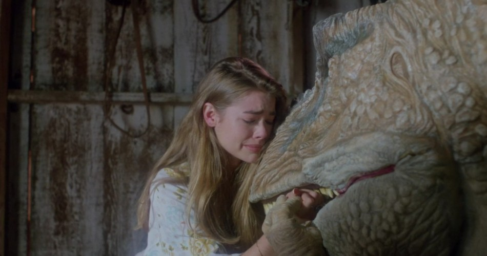 Tammy (Denise Richards) hugs Michael (Paul Walker) in T-Rex form and cries.