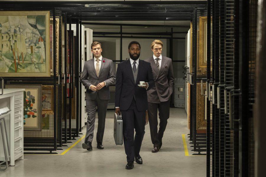 The Protagonist (John David Washington) walking through a vault with his partner Neil (Robert Pattinson).