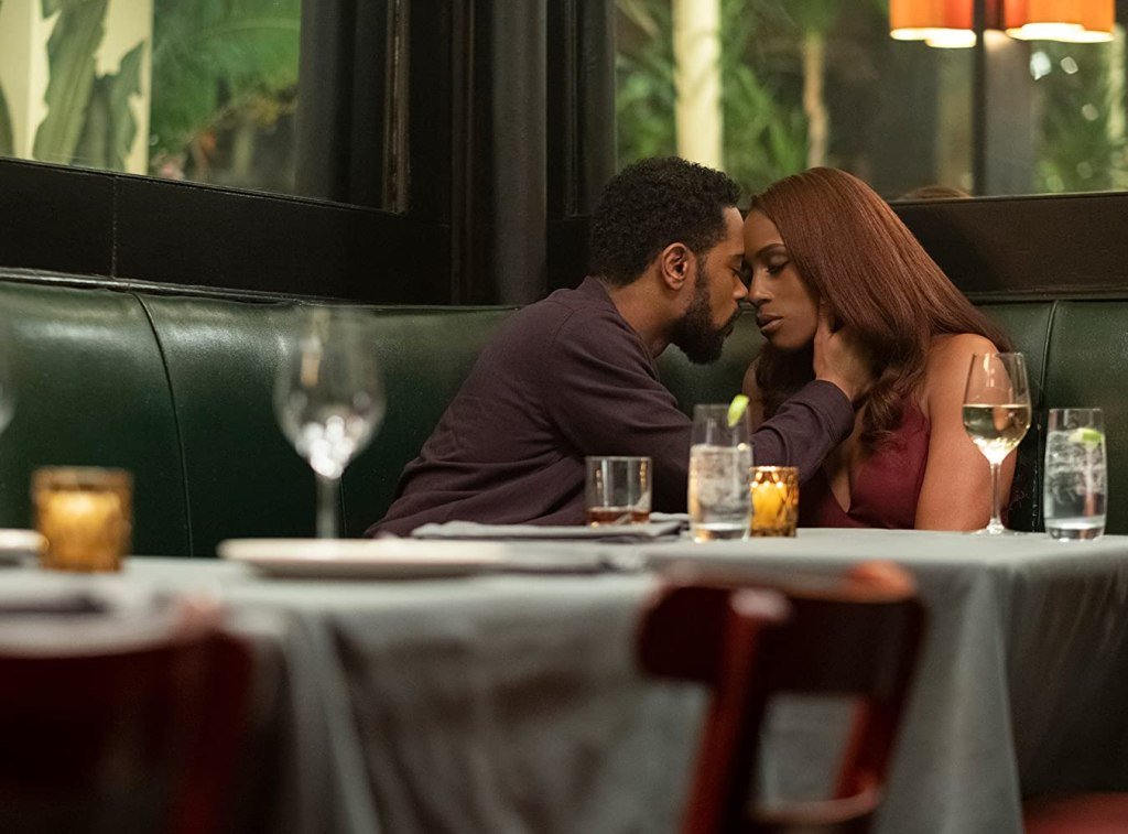 MIchael (LaKeith Stanfield) leaning in to kiss Mae (Issa Rae).