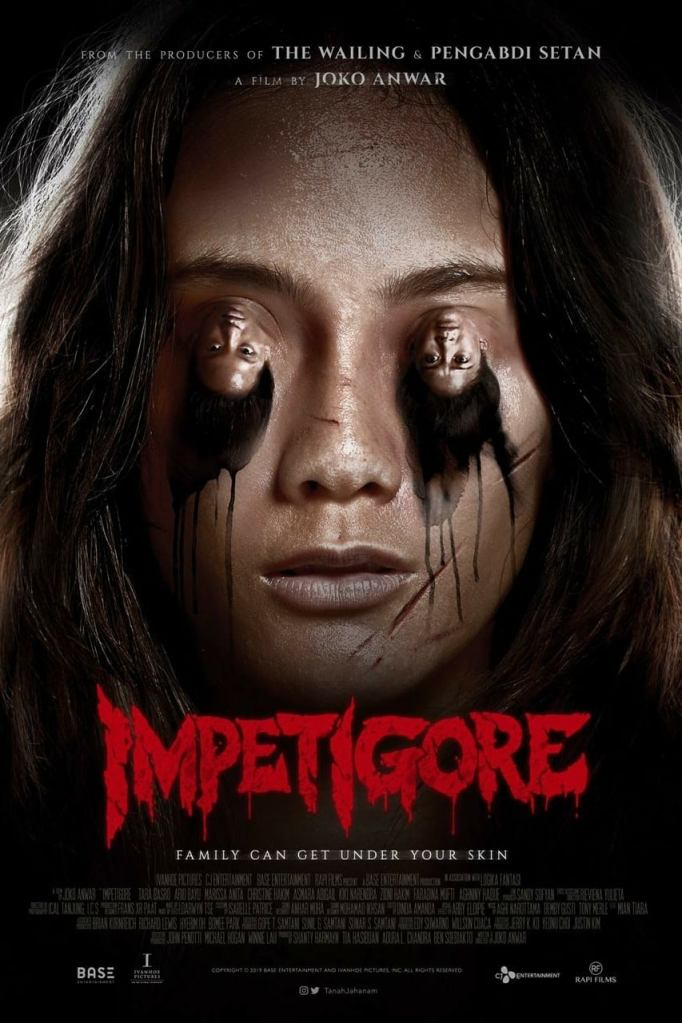 The film poster showing Maya's (Tara Basro) face, only instead of her eyes are two upside down heads.