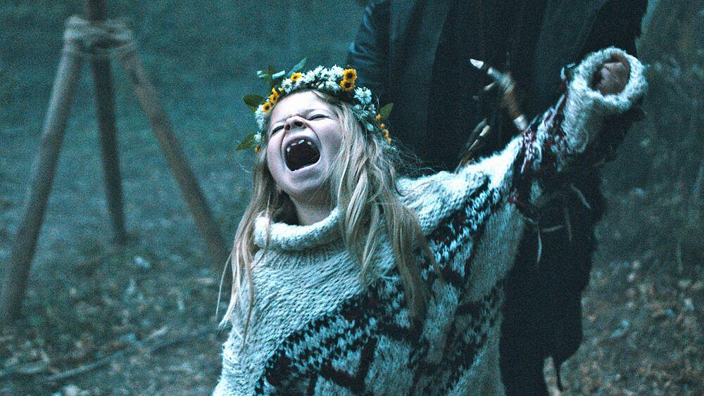 Raya (Katerina Lipovska) screaming at the top of her lungs.