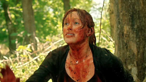 Dawn (Stephanie Thoreson) covered in blood.