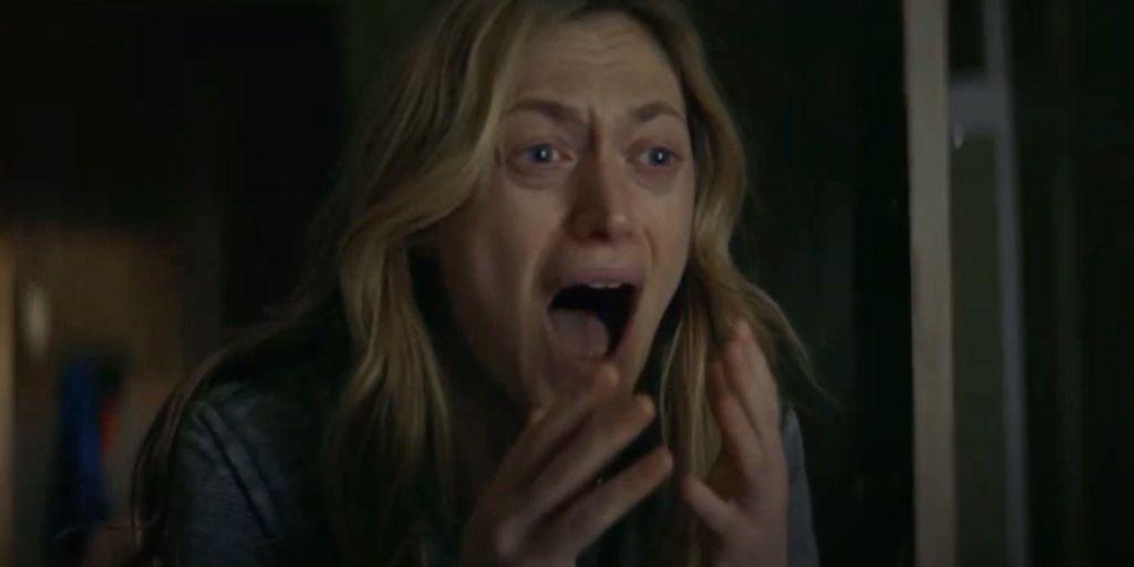 Louise (Marin Ireland) screaming.