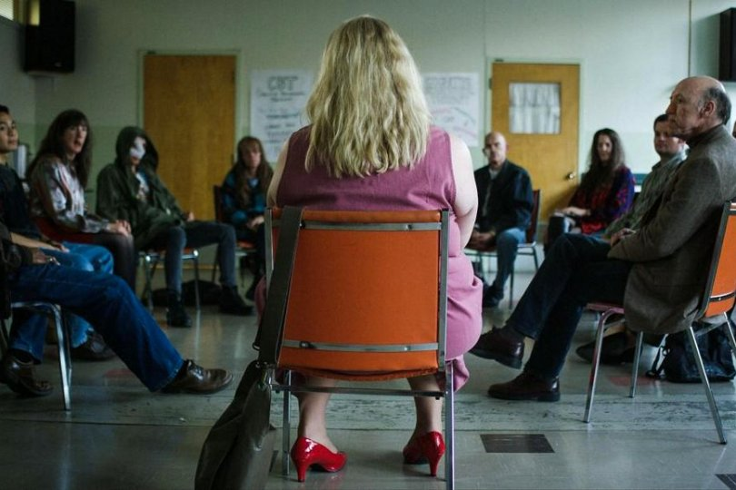 the self-help group sitting in a circle.
