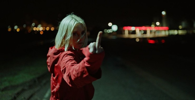 Eve (Lucie Debay) giving the finger.