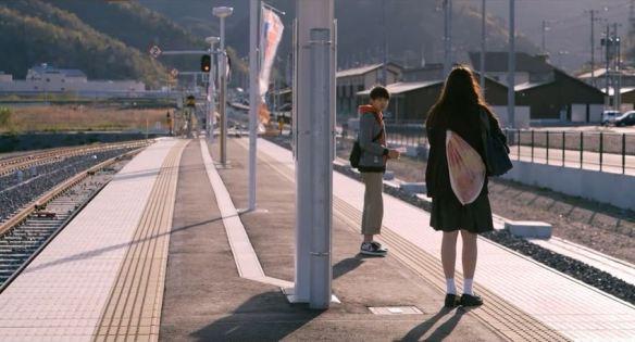 Haru (Serena Motola) at the train station.