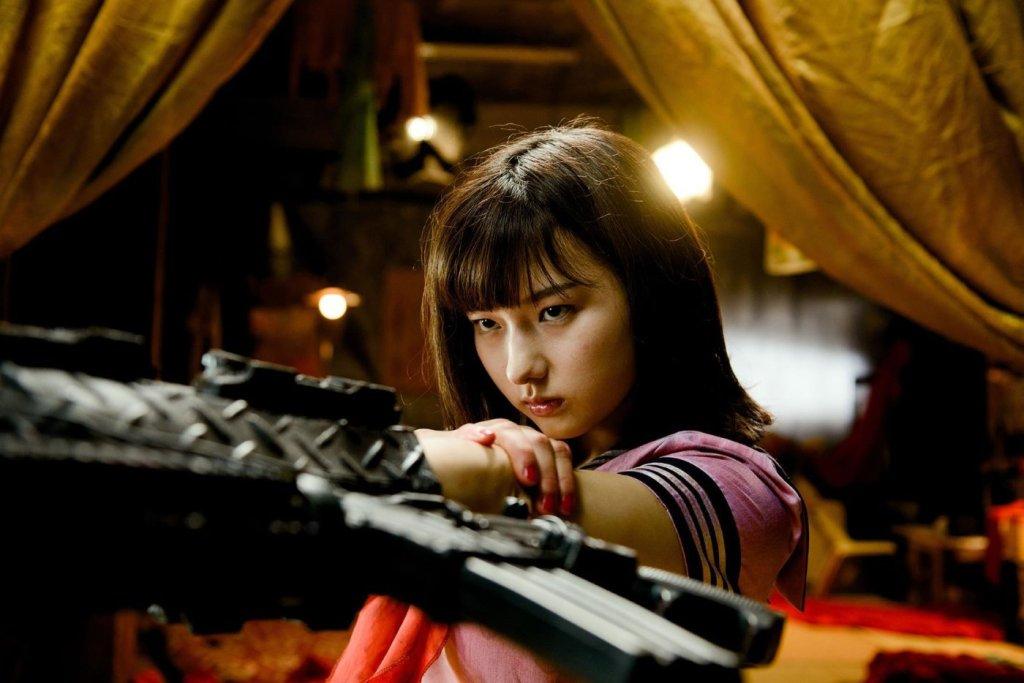 Ami (Himena Tsukimiya) aiming her machine gun arm.