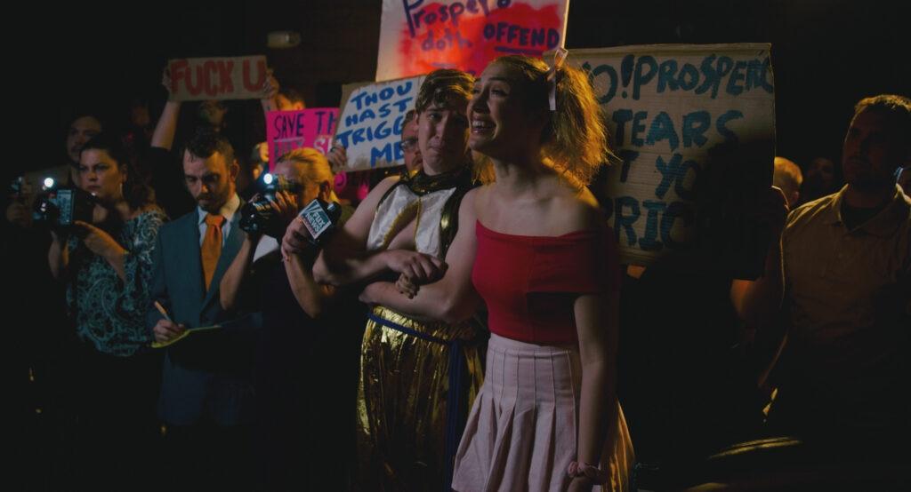 Ferdinand (Erin Patrick Miller) and Miranda (Kate McGarrigle) at a protest.