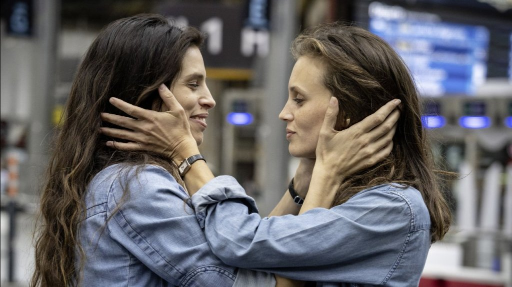 Neige (Maïwenn) and her sister Lilah (Marine Vacth) hugging each other.