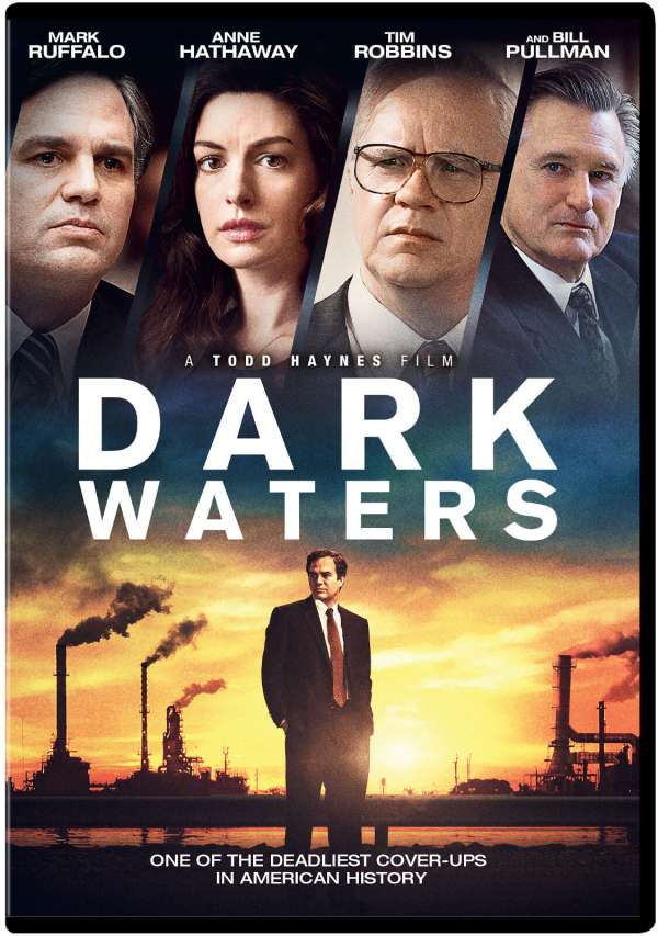 The film poster showing Rob Bilott (Mark Ruffalo) standing in front of a chemical plant. At the top of the poster we can see Rob Bilott, his wife Sarah (Anne Hathaway), his boss Tom Terp (Tim Robbins) and second lawyer Harry Dietzler (Bill Pullman).