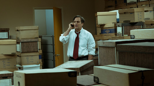 Rob Bilott (Mark Ruffalo) standing in a room full of document boxes.