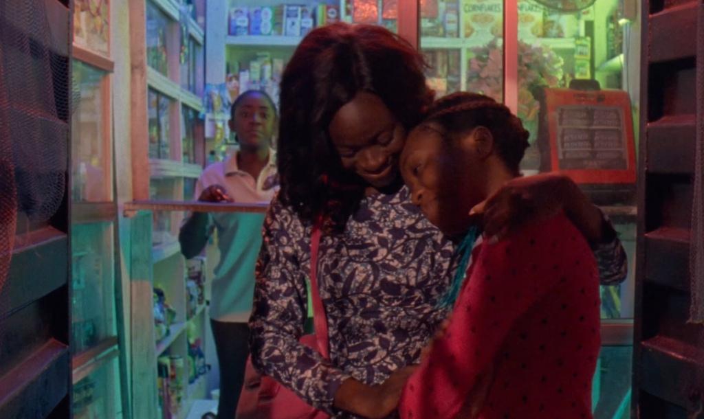Rosa (Temiloluwa Ami-Williams) hugging her sister Grace (Cynthia Ebijie).