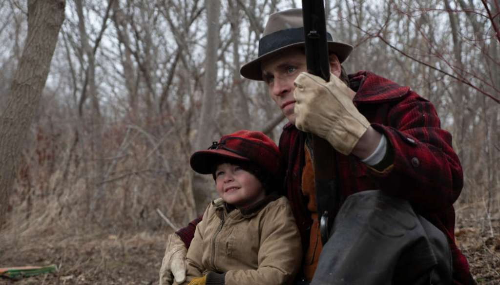 Willis (Sverrir Gudnason) going duck hunting with his son.