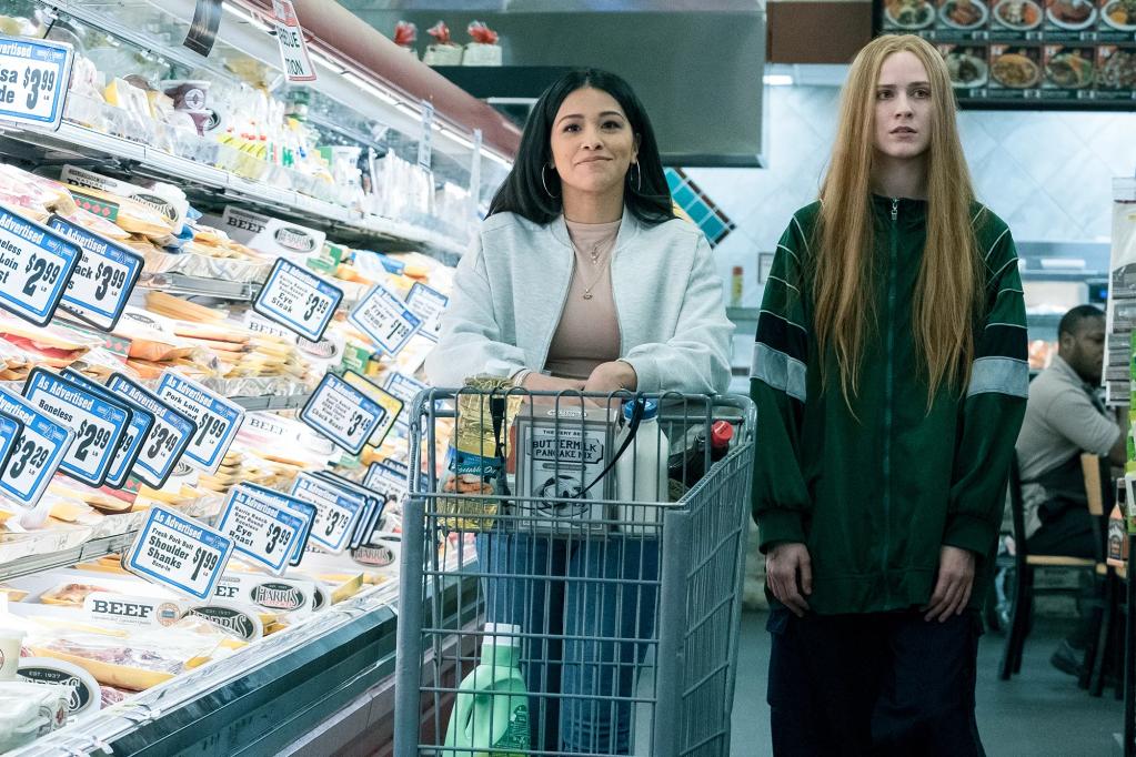Melanie (Gina Rodriguez) and Old Dolio (Evan Rachel Wood) going shopping.