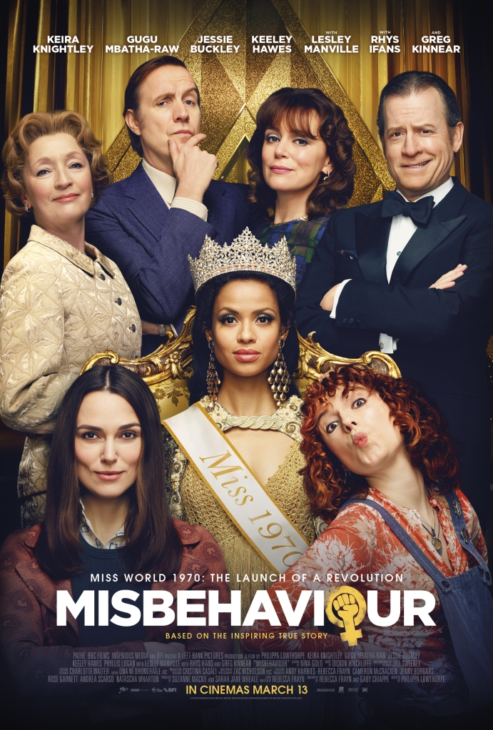 The film poster showing Jennifer Hosten (Gugu Mbatha-Raw) seated on a throne, Sally (Keira Knightley) and Jo (Jessie Buckley) in front of her and Dolores Hope (Leslie Manville), Eric Morley (Rhys Ifans), Julia Morley (Keeley Hawes) and Bob Hope (Greg Kinnear) behind them.