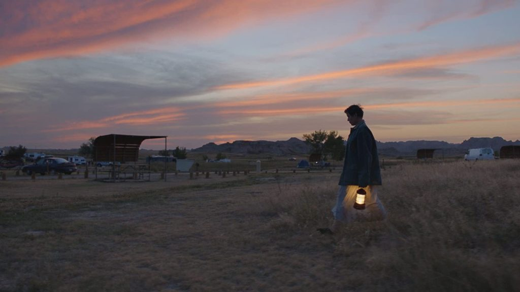 Fern (Frances McDormand) walking across a campground.