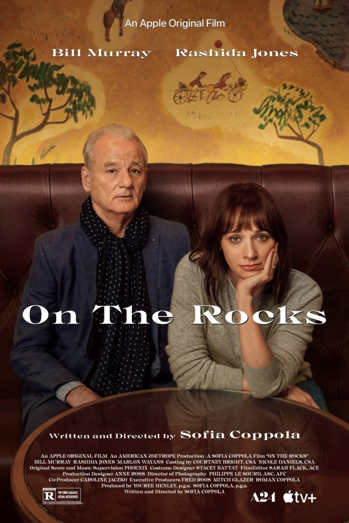 The film poster showing Laura (Rashida Jones) and Felix (Bill Murray) sitting at a table in a bar.