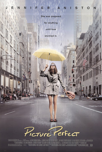 The film poster showing Kate (Jennifer Aniston) standing in the street with a yellow umbrella. It's raining, but just on her.