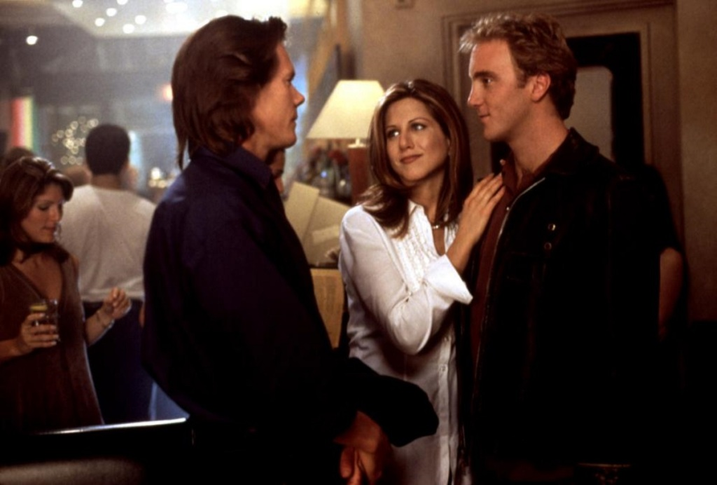 Kate (Jennifer Aniston) cuddles up to Nick (Jay Mohr) while talking to Sam (Kevin Bacon).