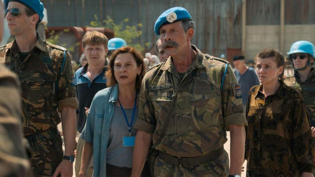 Aida (Jasna Djuricic) standing next to Colonel Karremans (Johan Heldenbergh) of the UN.