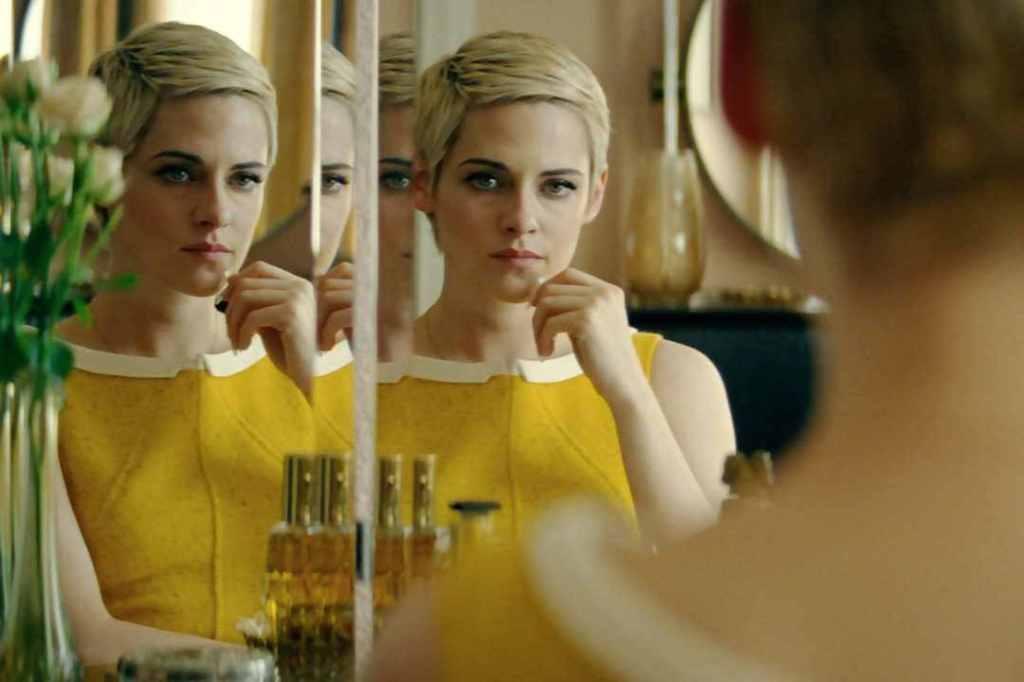 Jean Seberg (Kristen Stewart) looking at herself in a mirror.