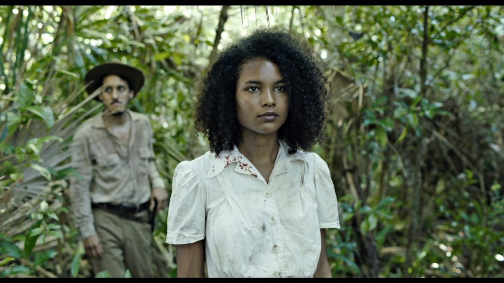 Agnes (Indira Rubie Andrewin) walking through the jungle.