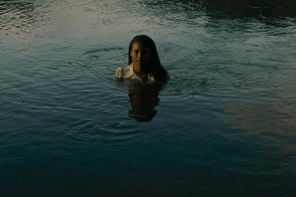Agnes (Indira Rubie Andrewin) in the river.