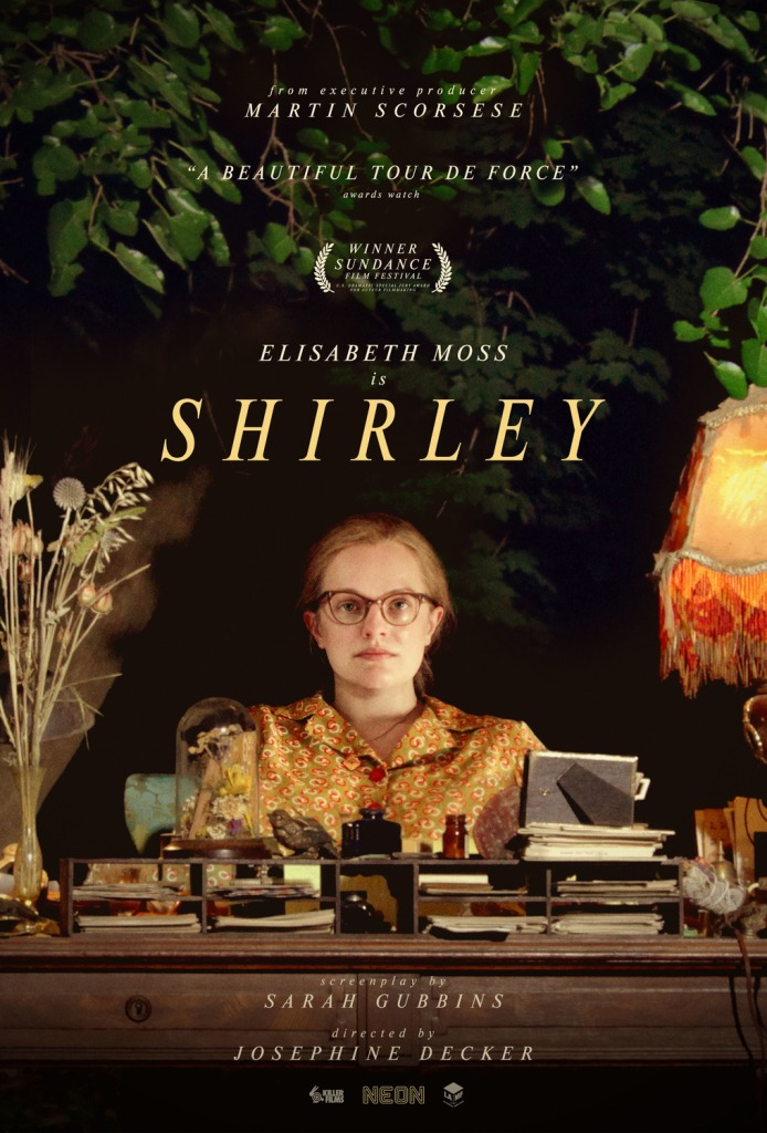 The film poster showing Shirley Jackson (Elisabeth Moss) sitting at a desk in the middle of the woods.