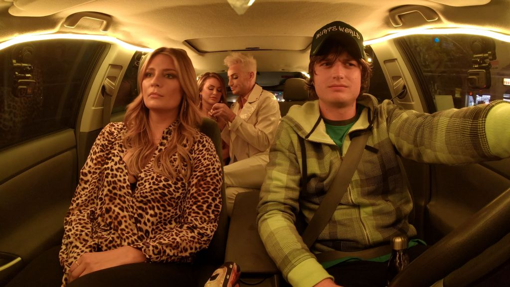 Kurt (Joe Keery) driving London (Mischa Barton) and her friends.