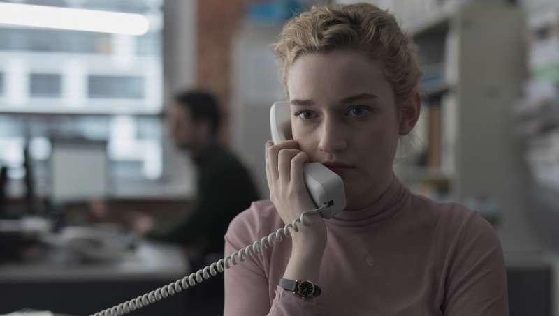 Jane (Julia Garner) on the phone, looking serious.